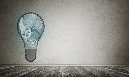 Glass lightbulb with multiple gears inside placed in empty room with grey wall on background. 3D rendering.