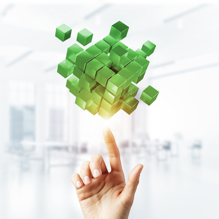 Close of businessman hand pointing at cube figure as symbol of innovation. 3D rendering