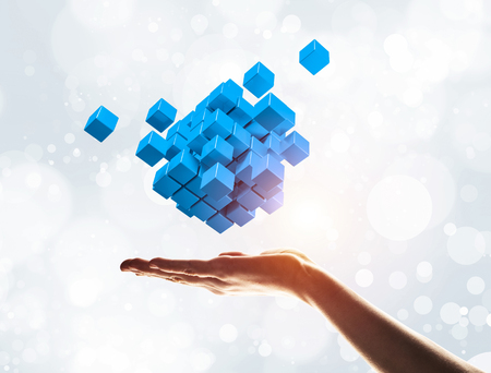 Close of businessman hand holding cube figure as symbol of innovation. 3D rendering Stock Photo - 113731341