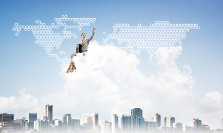 Businesswoman sit on cloud over city and pointing at icon in air 스톡 콘텐츠