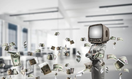 Cropped image of business woman in suit with old TV instead of head keeping arms crossed while standing among flying dollars planes inside office building.
