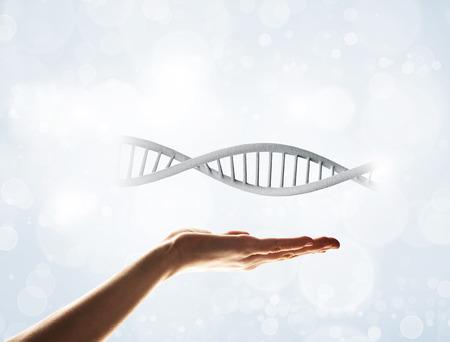 Close of human hand showing DNA molecule bokeh background Stok Fotoğraf