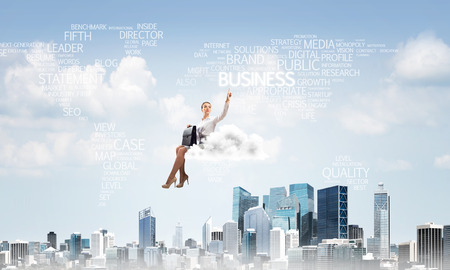 Businesswoman sit on cloud over city and pointing somewhere
