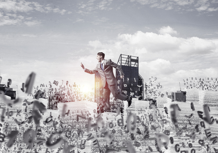 Businessman in suit running with phone in hand among flying letters with sunlight and cityscape on background. Mixed media.