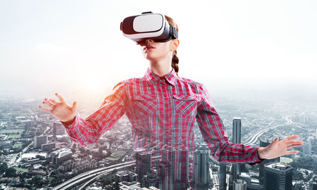 Young caucasian woman in virtual reality helmet against cityscape background