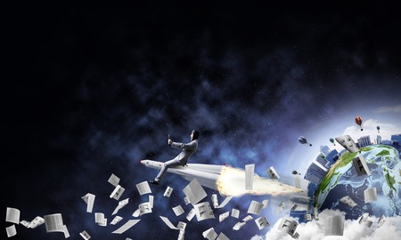Conceptual image of young businessman in suit flying on rocket among flying papers with planet Earth and open space on background. Elements of this image are furnished by NASA. Stock Photo