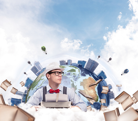 Portrait of man writer looking away and using typing machine while sitting at the table with flying books and Earth globe among cloudy skyscape on background. Elements of this image furnished by NASA