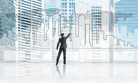 Young businessman in suit at balcony against morning cityscape background. 3d rendering Zdjęcie Seryjne
