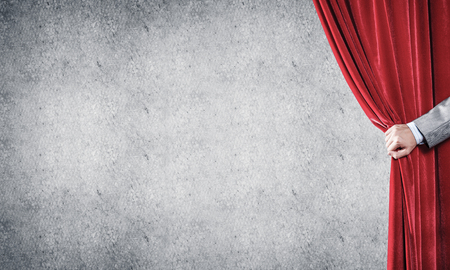 Close up of businessman hand open red velvet curtain. Place your text Foto de archivo - 115881803