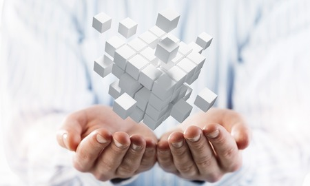 Close of businessman hand holding cube figure as symbol of innovation. 3D rendering Imagens