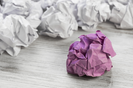 Set of crumpled paper balls with one colorful Stock fotó