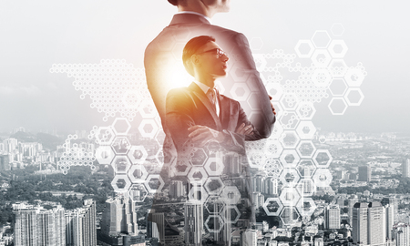 Double exposure of elegant businessman and modern busines city with towers and skyscrapers Stock Photo