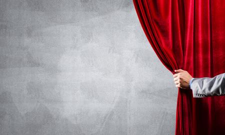 Close up of businessman hand open red velvet curtain. Place your text Foto de archivo - 116367302