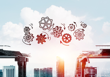 Sketched gear mechanism over gap in concrete bridge as symbol of teamwork and problem solving. Cityscape and sunlight on background. 3D rendering. Stockfoto - 116385695
