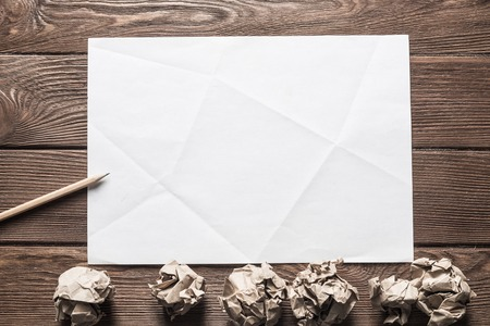 Close up of sheet of white paper and pencil on wooden table Stock Photo - 116305762