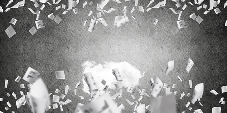 Little cloud flying among multiple flying paper documents with gray dark wall on background.