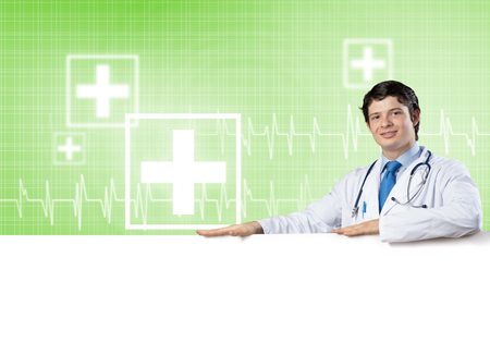 Young handsome doctor holding white blank banner. Place your text Stock Photo - 116845077