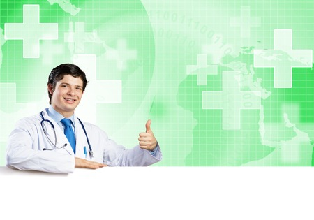 Young handsome doctor holding white blank banner. Place your text Stock Photo - 116893324