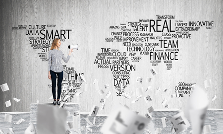 Woman in casual wear standing among flying documents with speaker in hand with business-related terms in form of world map on background. Mixed media. Stock Photo