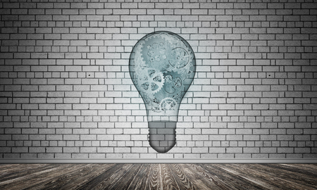 Glass lightbulb with multiple gears inside placed in empty room with grey brick wall on background. 3D rendering.