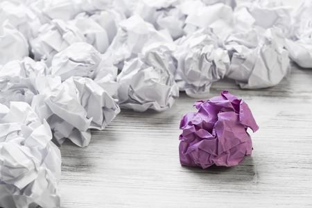 Set of crumpled paper balls with one colorful Stock Photo