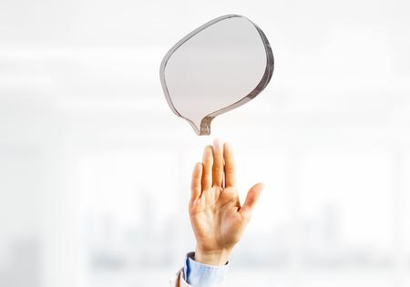 Close of businessman hands touching glass speech bubble as internet concept. Mixed media Reklamní fotografie - 117560166