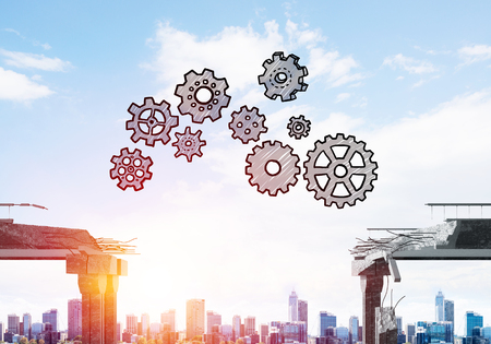 Sketched gear mechanism over gap in concrete bridge as symbol of teamwork and problem solving. Cityscape and sunlight on background. 3D rendering. Фото со стока