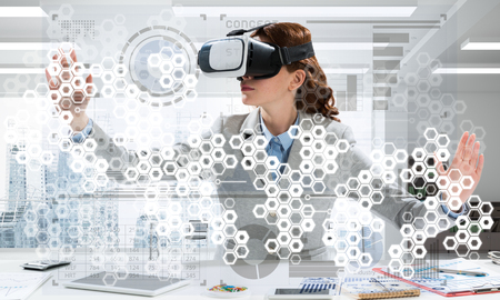 Conceptual image of confident young business woman in suit using virtual reality headset and digital media interface while sitting inside bright office building.