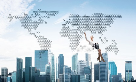 Businesswoman sit on cloud over city and pointing at icon in air 写真素材 - 118753978