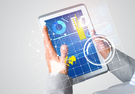 Close of businessman hands holding tablet pc with infographs on screen