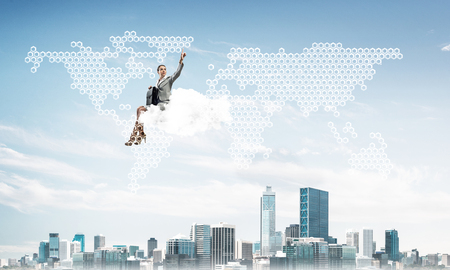 Businesswoman sit on cloud over city and pointing at icon in air Imagens