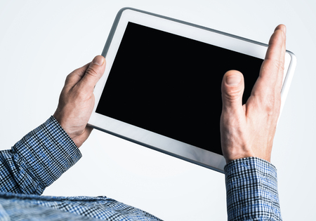 Close up of businessperson using digital tablet with blank display Stock Photo