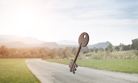 Key stone figure as symbol of access outdoor against natural landscape Stock Photo - 119325486
