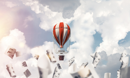 Colorful aerostat flying among paper documents and over the blue cloudy sky. 3D rendering. Stok Fotoğraf