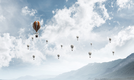 Beautiful nature landscape with flying balloons among high mountains and cloudly skyscape. 3D rendering. Imagens