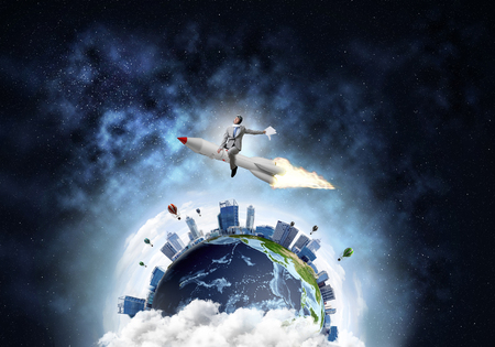 Conceptual image of young businessman in suit flying on rocket with planet Earth and open space on background. Elements of this image are furnished by NASA.