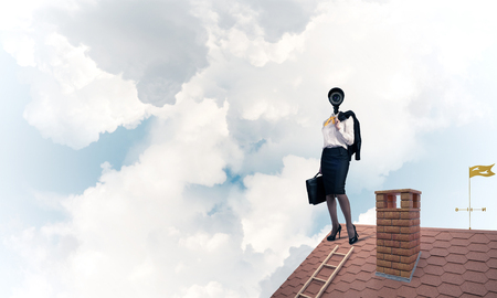 Faceless businesswoman with camera zoom instead of head standing on house roof Stok Fotoğraf