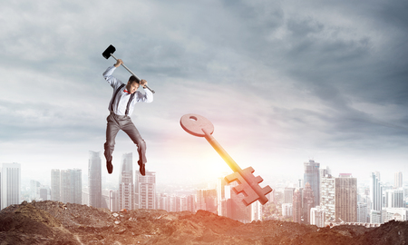 Jumping businessman crashing big key symbol with city view and sunlight on background. 3D rendering.