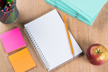 Back to school concept with blank notepad stickers and pencil on wooden surface Imagens