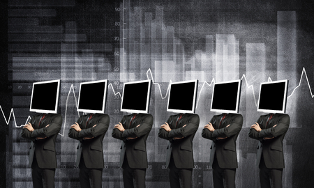 Businessmen in suits with monitors instead of their heads keeping arms crossed while standing against analytical charts drawn on wall on background.