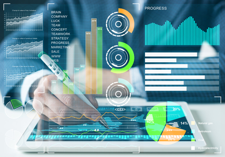 Businessman analyzing financial data at tablet computer. Interactive financial diagrams, trading indicators and exchange indexes. Innovation technology and global business corporation concept
