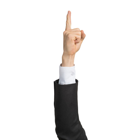 Businessman hand in suit showing finger pointing gesture with forefinger. Human hand gesturing sign isolated on white background studio shot. Businessman raised arm presenting popular gesture.