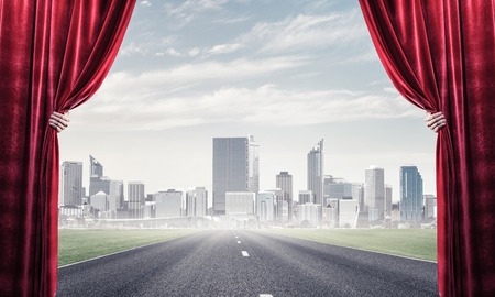 Human hand opens red velvet curtain to landscape with road Stock Photo - 121206560