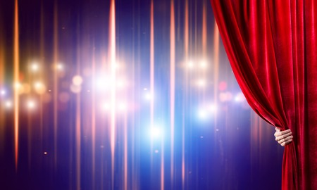 Close up of businessman hand open red velvet curtain of stage Stock Photo