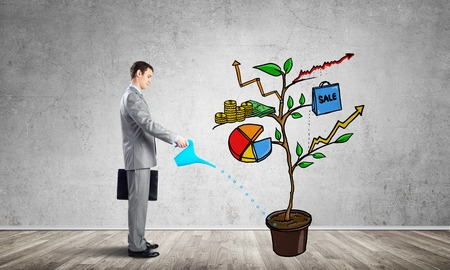 Businessman watering drawing tree consisted of infographic symbols. Planning and strategy of growth. Friendly ecosystem for company development. Professional consulting and assistance.