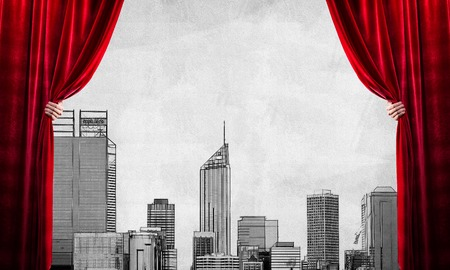 Close up of businessman hand open red velvet curtain and drawn cityscape at background