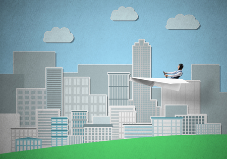 Businessman in aviator hat sitting in paper plane and holding steering wheel. Happy pilot driving paper plane on background of cartoon business center with high skyscrapers and office buildings.