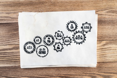 Business process management pencil hand drawn with group of rotating cogwheels. Stock Photo