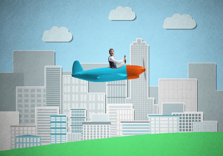 Businessman sitting in small propeller plane and flying above metropolis.