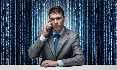 Internet consultant talking on phone. Businessman sitting at desk on background binary computer code. Portrait of hosting service manager wears business suit and tie. Internet consulting and marketing